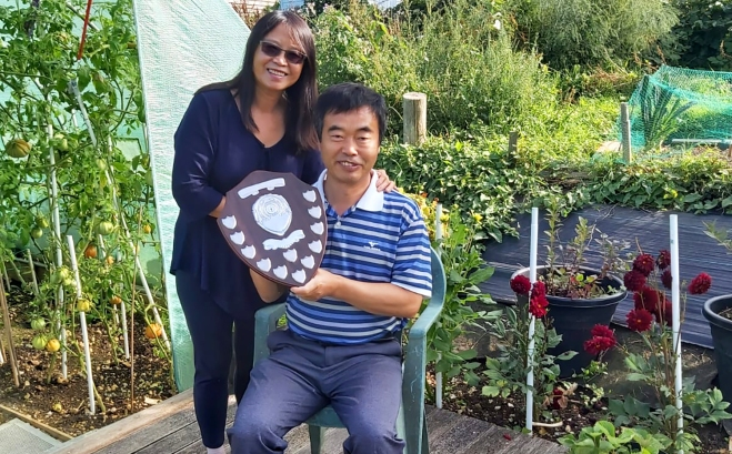 Peter and Joy with the trophy shield