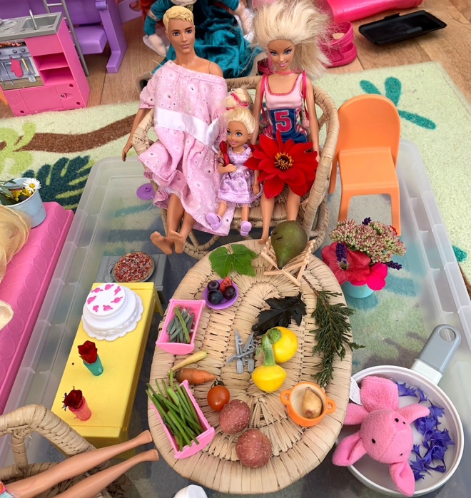 Barbie and Ken enjoying a spread of micro sized fruit and veg harvested at the show