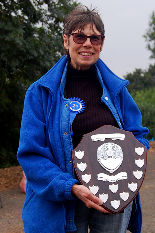 Happy 'Plot Holder of the Year' Gill with the coveted trophy shield